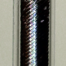 The 3D-printed endoscope, consisting of a transparent glass fibre, a guiding tube for fiber rotation (black) and a transparent sheath for protection, has an overall diameter of less than 0.5 mm.